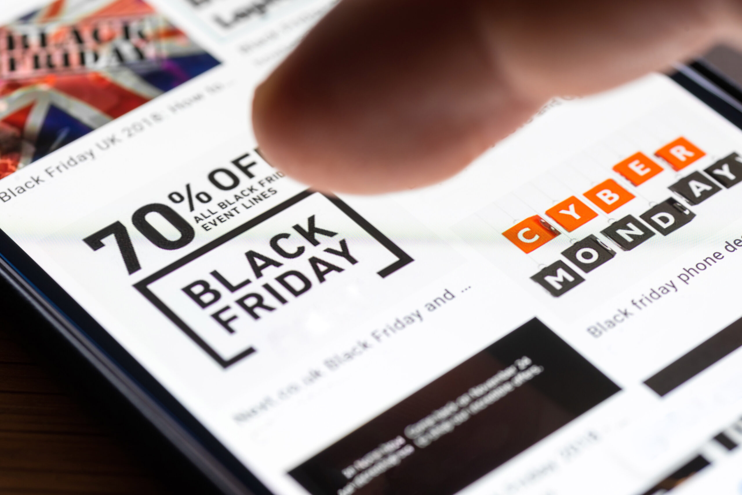 70% off coupon on mobile with user's finger hovering over deal